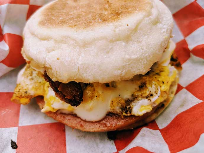 Tailgating Breakfast Sandwich Meal Prep - English Muffin Breakfast Sandwich on Red and White Checker Board Food Basket Wrapper