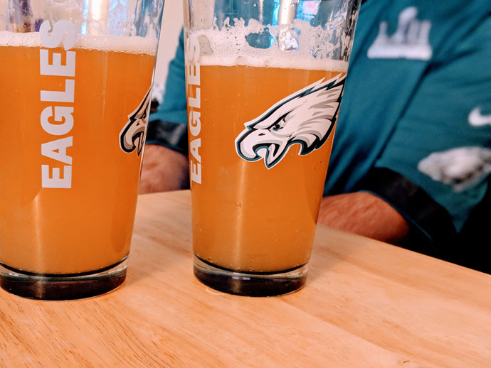 Super Bowl Drinks - Beer in Eagles Pint Glasses with Fan in the Background