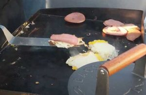 Breakfast Sandwich Stacks on a Tailgate Grill with Pork Roll, Egg, and Cheese