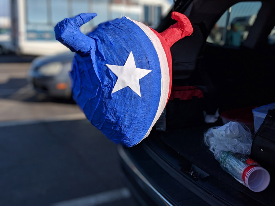 DIY Paper Mache Pinatas - NFL Houston Texans Red, White and Blue Bull Pinata hanging from SUV Tailgate